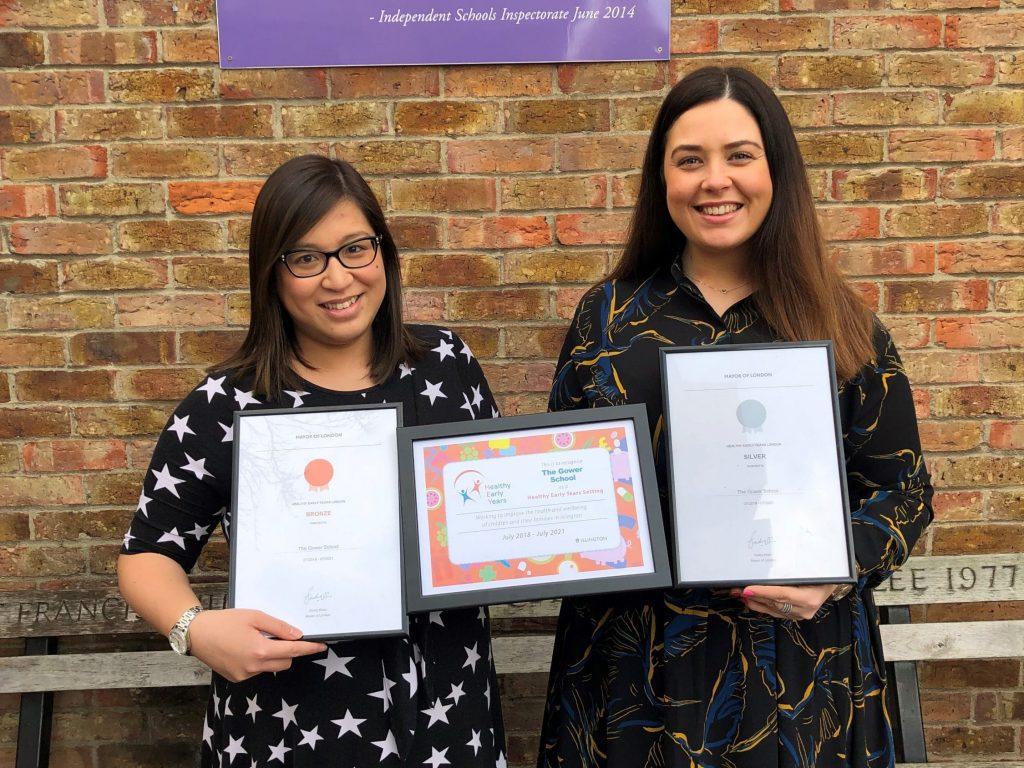 The Gower School Head of Nursery and Deputy Head of Nursery with HEYL awards