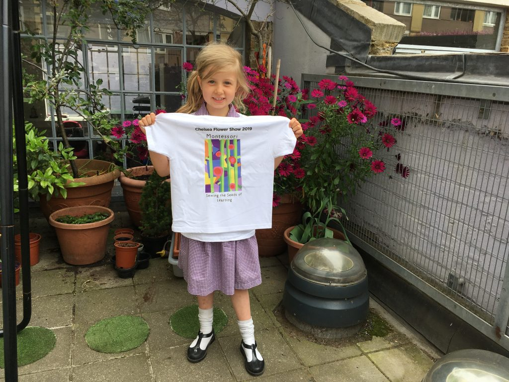 The Gower School child holding her winning artwork print on the Chelsea Flower Show 2019 Montessori Garden