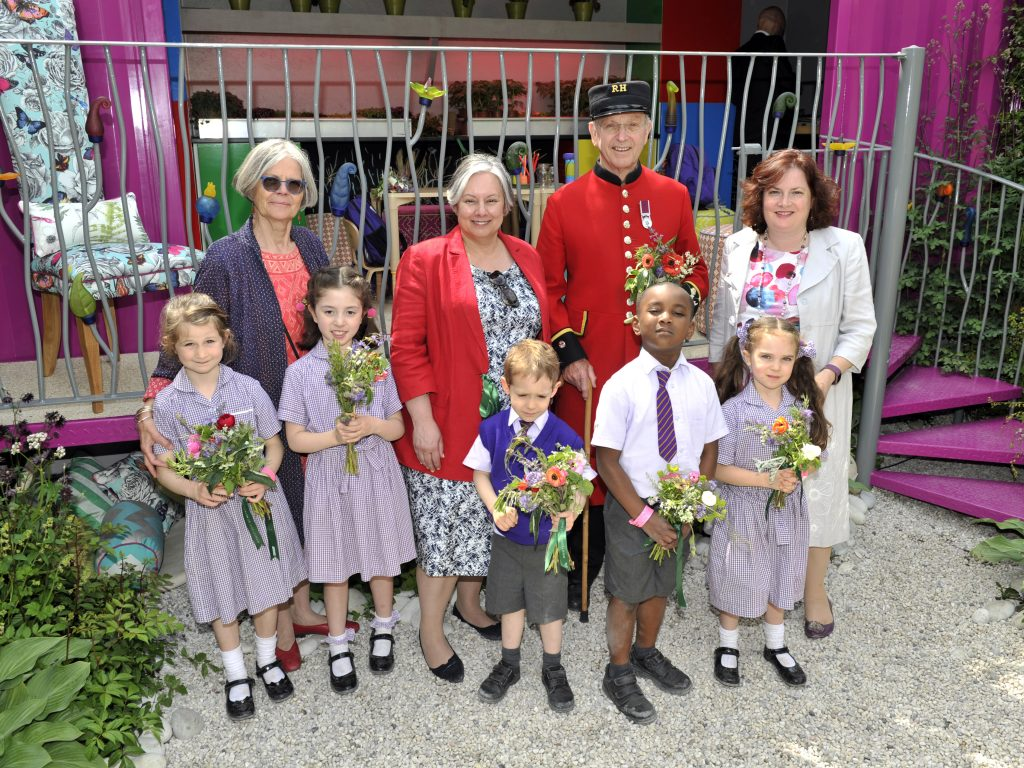 Montessori school children from The Gower School with Miss Emma Gowers, Chelsea Pensioner and Montessori Groups representatives at the RHS Chelsea Flower Show 2019