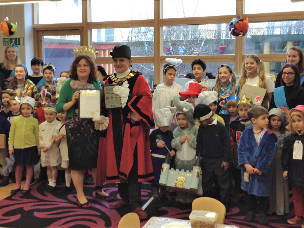 The Gower School Principal Miss Gowers with the Mayor of Islington presenting TfL STARS Gold awards in a classroom of children in costumes