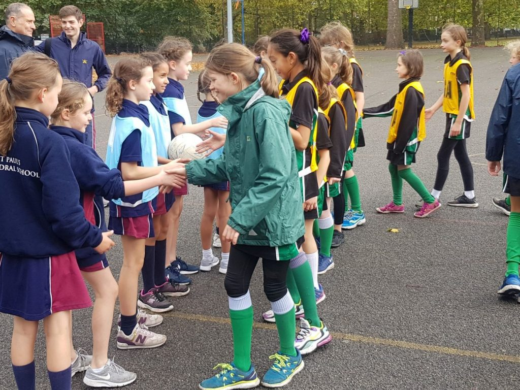 The Gower School girls winners netball team shake hands with the opposition team
