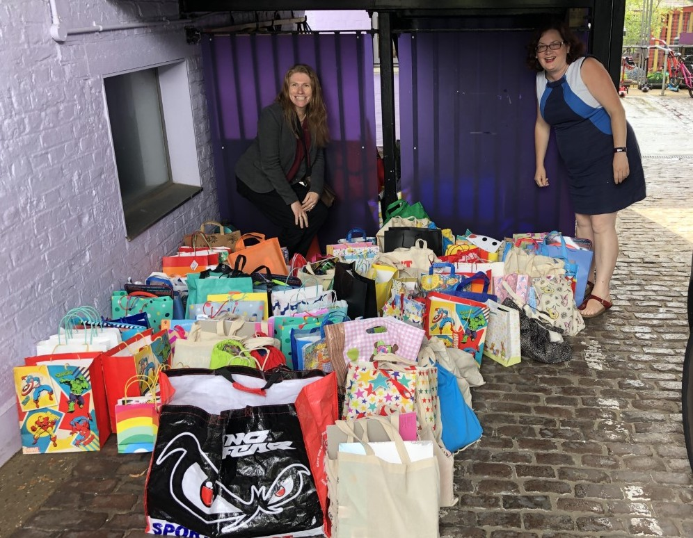 Laura Eden from Islington Council collects Kindness Bags donated by TGS families.